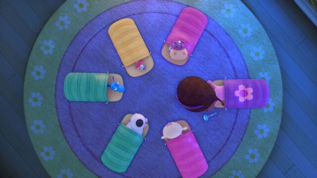 File:Doc and toys in their sleeping bags.jpg