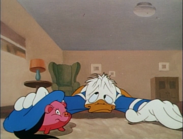 File:Donald with a piggy bank.png