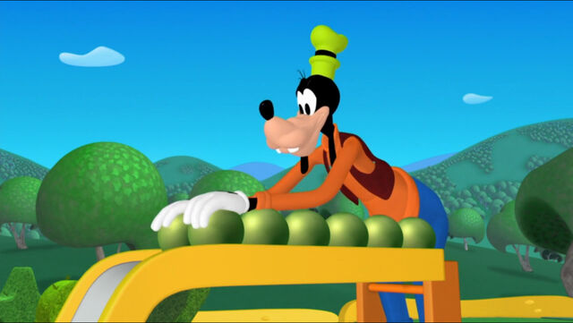 File:Goofy rolls the beans down the slide.jpg