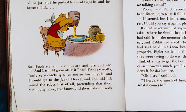 File:Winnie the Pooh is eating some more honey.jpg