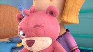 Pink teddy bear winking