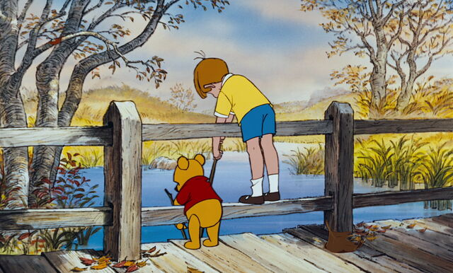 File:Christopher Robin and Pooh Bear are both on a bridge.jpg