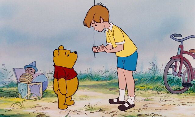 File:Winnie the Pooh has told Christopher Robin he wants to use the blue balloon to get honey.jpg