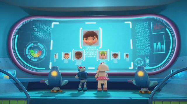 File:Lambie and robot ray looking at the kids on screen.jpg