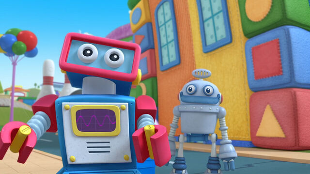 File:Two toy robots.jpg