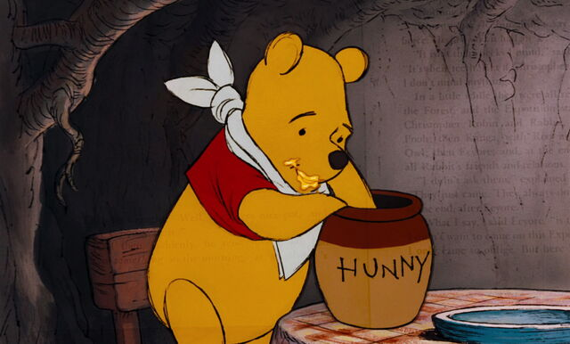 File:Winnie the Pooh enjoys his yummy honey.jpg