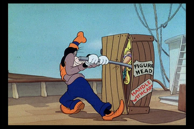 File:Goofy opening up a mermaid crate.png