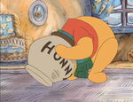 Winnie the Pooh has got his head stuck in the honey pot