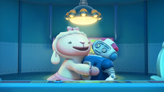 File:Lambie hugs robot ray.jpg