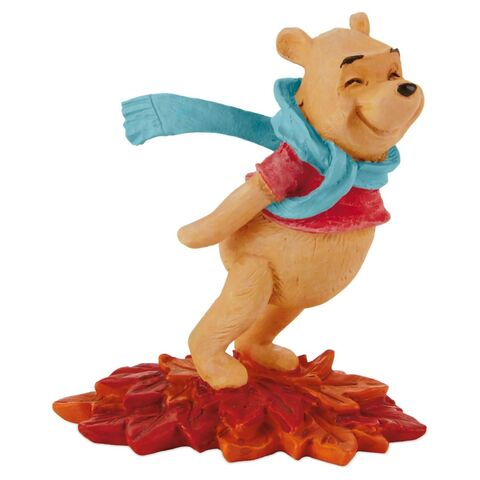 File:Pooh-leaning-in-the-wind-figurine-root-Hallmark.jpg
