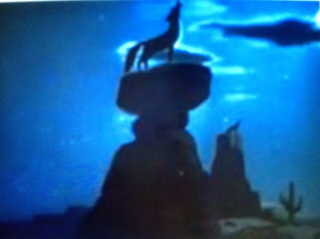 File:Coyote Howling at the moon on rock Pecos Bill Melody Time.jpeg