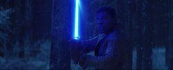 Finn Holding Lightsaber