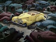 A beaten used up yellow motor car