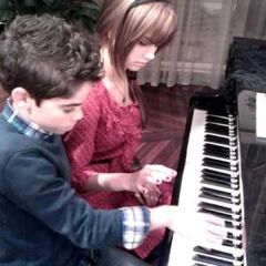 debby ryan and cameron boyce playing in piano