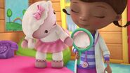 Doc holding a mirror for Lambie