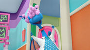 Stuffy with purple cottonballs on his head