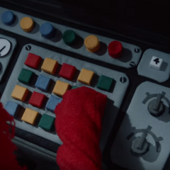 Red Guy pushing the machine's buttons