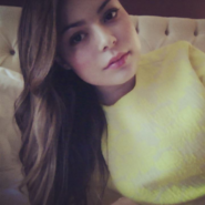 Miranda Cosgrove in her bed