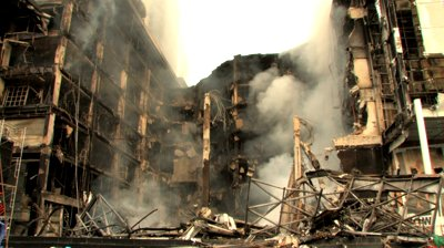 Stock-footage-smoking-ruins-of-destroyed-building