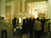 Photograph of lots of people looking at and taking photographs of the Rosetta Stone, and the Rosetta Stone