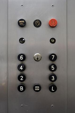 File:Old OTIS Black Buttons 2.png