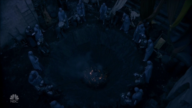 File:The Wizard has the High Council chained to the pit holding the young witch.png