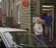 Emmie outside shop 1991