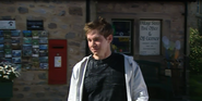 Emmie robert sugden outside the shop