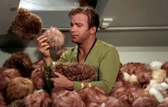 Kirk surrounded by Tribbles.png