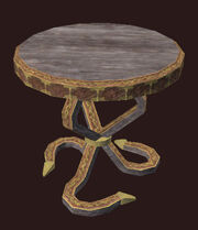 A Small Ornate Freeport End Table Placed
