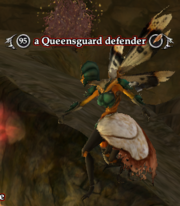 A Queensguard defender