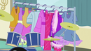 A costume rack rolls in front of Pinkie EG3