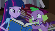 Spike gives the yearbook to Twilight EG