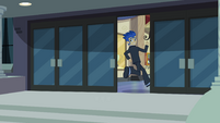 Flash runs into the school EG