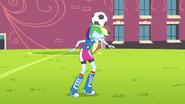 Rainbow balancing a soccer ball on her head EG