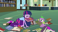 Twilight holding book in her mouth EG