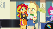 Applejack puts arm around Sunset Shimmer EG2