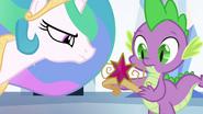 Spike holding fake Element of Magic EG