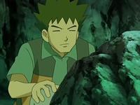 Archivo:EP558 Brock examinando las rocas.png