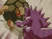 EP063 Nidoking golpeando a Golem