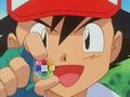 EP026 Ash con la medalla Arcoiris.png