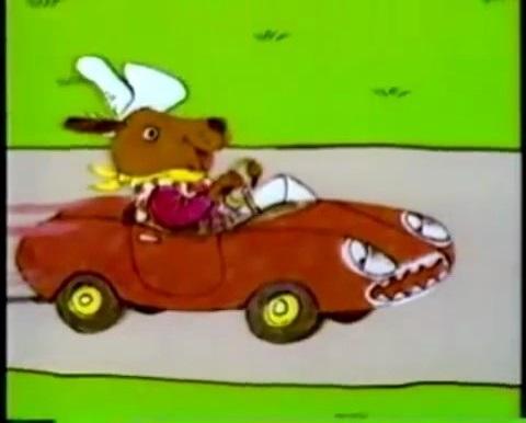 File:Dingo In His Car Red.jpg