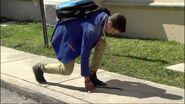 Daniel tying shoe