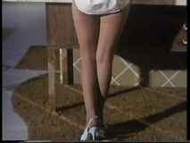 Barbara's legs with white shoes (Nancy Kovack)