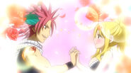 Natsu holds Lucy's hands