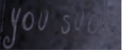 File:YousuckGraffitiInWorld.png