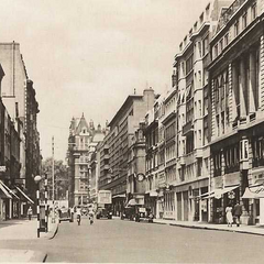 The trendy West Street of Blithebeth, a very famous row in the 1960's, though note that this tumult hadn't yet occurred; this was 1956, after all. The new Co-Op stands rather ostentatiously in an—albeit shiny—blemished white.