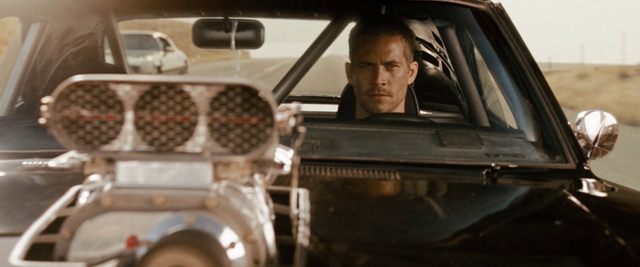 File:Brian driving Dom's Dodge Charger.png