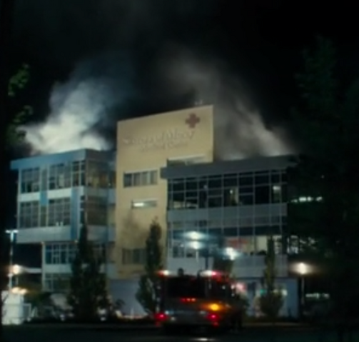 File:Smoke is coming from the roof of the building.png