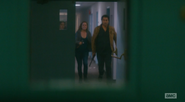 Travis and Madison arrive at the stairwell